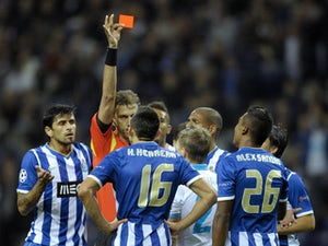 Italian referee Paolo Tagliavento shows the red card to Porto's Mexican midfielder Hector Herrera during the UEFA Champions League Group G football match FC Porto vs Zenit at the Dragao Stadium in Porto on October 22, 2013