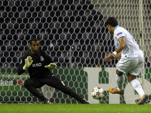 Zenit's Brazilian forward Hulk tries to score past Porto's Brazilian goalkeeper Helton Aruda during the UEFA Champions League Group G football match FC Porto vs Zenit at the Dragao Stadium in Porto on October 22, 2013