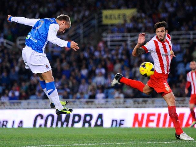 Antoine Griezmann of Real Sociedad de Futbol scores his team's second goal during the La Liga match between Real Sociedad de Futbol and UD Almeria at Estadio Anoeta on October 27, 2013