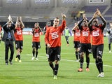 Renne's players celebrate after their victory 5-0 during the French L1 football match Toulouse vs Rennes on October 26, 2013