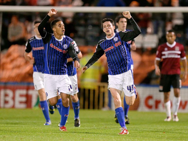 Ian Henderson of Rochdale celebrates with team mate Bastien Hery after scoring his sides 1st goal during the Sky Bet League Two match between Rochdale and Northampotn Town at Spotland Stadium on October 22, 2013
