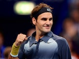 Roger Federer celebrates his win against Grigor Dimitrov during their Swiss Indoors quarter-final tennis match on October 25, 2013
