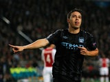 Samir Nasri of Manchester City celebrates scoring the first goal of the game during the Group D UEFA Champions League match between AFC Ajax and Manchester City FC at Amsterdam ArenA on October 24, 2012