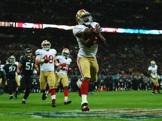 Vernon Davis of the San Francisco 49ers scores a touchdown during the NFL International Series game between San Francisco 49ers and Jacksonville Jaguars at Wembley Stadium on October 27, 2013