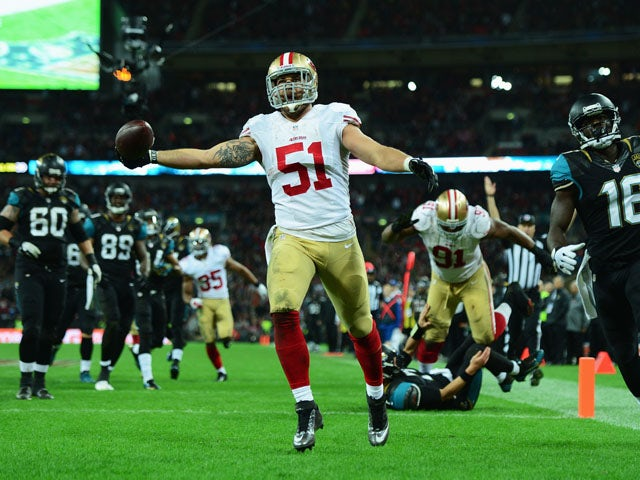 Dan Skuta of the San Francisco 49ers scores a touchdown during the NFL International Series game between San Francisco 49ers and Jacksonville Jaguars at Wembley Stadium on October 27, 2013