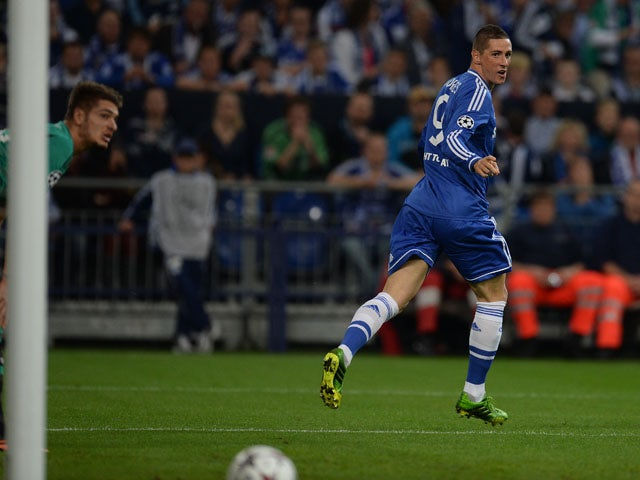 Chelsea�s Spanish striker Fernando Torres celebrates during the UEFA Champions League Group E football match Schalke 04 vs FC Chelsea in Gelsenkirchen, western Germany on October 22, 2013