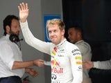Sebastian Vettel waves to the crowd after qualifying first during the Formula One India Grand Prix on October 26, 2013