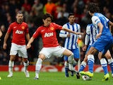 Manchester United's Japanese midfielder Shinji Kagawa vies with Real Sociedad's defender Carlos Martinez during the UEFA Champions League football match on October 23, 2013