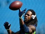 Sidney Rice of the Seattle Seahawks warms up before a game against the Carolina Panthers at Bank of America Stadium on September 8, 2013