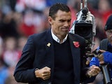 Sunderland's Uruguayan manager Gus Poyet celebrates at the final whistle of the English Premier League football match between Sunderland and Newcastle United at The Stadium of Light in Sunderland, northeast England on October 27, 2013