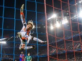 Schalke's goalkeeper Timo Hildebrand falls after trying to deflect the ball during the UEFA Champions League group E football match FC Basel against FC Schalke 04 on October 1, 2013
