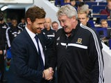 Manager Andre Villas Boas of Spurs shakes hands with Manager Steve Bruce of Hull City during the Barclays Premier League match between Tottenham Hotspur and Hull City at White Hart Lane on October 27, 2013