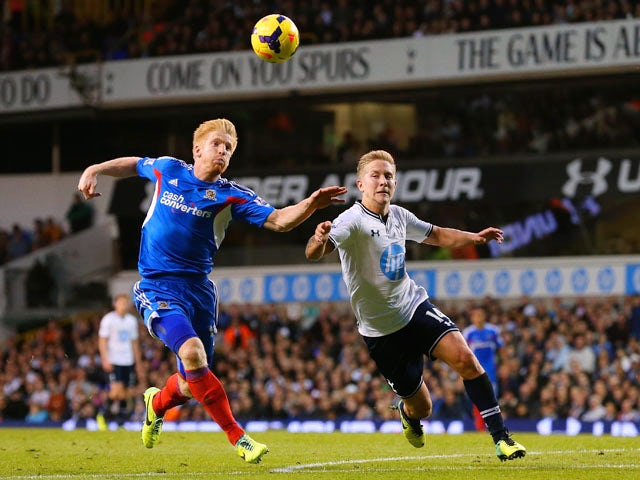 Lewis Holtby of Spurs clashes with Paul McShane of Hull City during the Barclays Premier League match between Tottenham Hotspur and Hull City at White Hart Lane on October 27, 2013