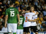 Valencia's midfielder Sergio Canales celebrates his goal with teammates during the UEFA Europa league Group A football match Valencia FC vs FC St. Gallen at the Mestalla stadium in Valencia on October 24, 2013