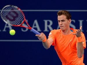 Vasek Pospisil in action against Ivan Dodig during their Swiss Indoors quarter-final tennis match on October 25, 2013