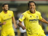 Villarreal's Mexican forward Giovani Dos Santos celebrates his goal during the Spanish league football match Villarreal CF vs Valencia CF at the El Madrigal stadium in Villareal on October 27, 2013