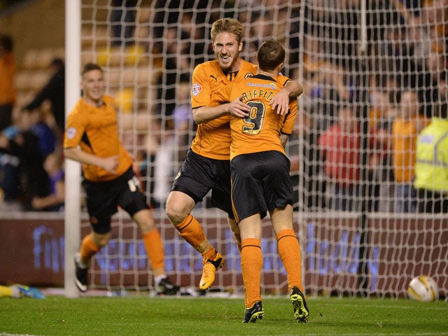 James Henry of Wolves celebrates scoring the first goal with team mate Leigh Griffiths during the Sky Bet League One match between Wolverhampton Wanderers and Oldham Athletic at Molineux on October 22, 2013