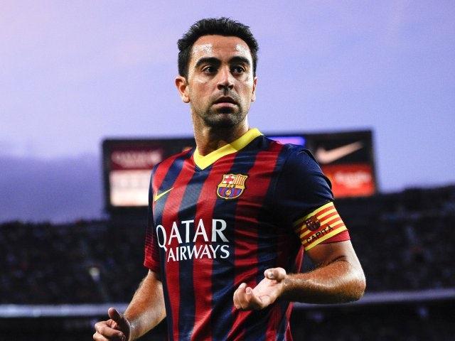 Xavi prepares to take a corner for Barcelona against Sevilla on September 14, 2013.