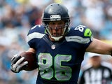 Zach Miller of the Seattle Seahawks runs with the ball as Jon Beason of the Carolina Panthers tries to make a tackle during their game on September 8, 2013