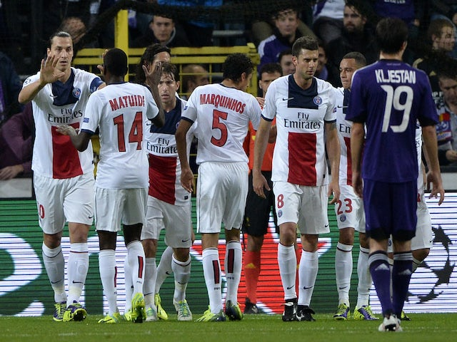 Paris Saint-Germain's Swedish forward Zlatan Ibrahimovic celebrates with teammates after scoring his team's first goal during the UEFA Champions League group C football match against Anderlecht on October 23, 2013