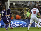 Paris Saint-Germain's Swedish forward Zlatan Ibrahimovic watches his shot go in for his and his team's third goal during the UEFA Champions League group C football match against Anderlecht on October 23, 2013