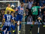 Schalke's Adam Szalai heads in the opening goal against Hertha on November 2, 2013