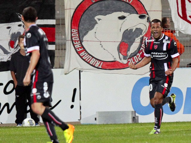 Valenciennes French midefielder Matthieu Dossevi celebrates after scoring a goal during the French L1 football match Ajaccio against Valenciennes on November 2, 2013