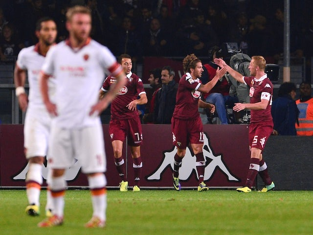 Torino's midfielder Alessio Cerci celebrates with teammates after scoring during the Italian Serie A football match Torino vs AS Roma at 'Olympic Stadium' in Turin on November 3, 2013