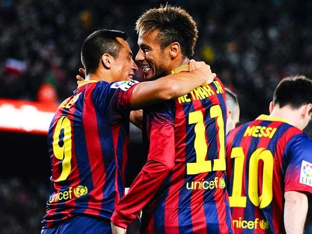 Barcelona's Alexis Sanchez celebrates with teammate Neymar after scoring the opening goal against Espanyol on November 1, 2013