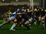 Bath's Anthony Perenise powers his way through the Worcester Warriors players to score a try on November 11, 2013