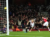 Arsenal's Spanish midfielder Santi Cazorla scores the opening goal during the English Premier League football match between Arsenal and Liverpool at the Emirates Stadium in north London, on November 2, 2013