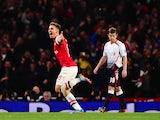 Aaron Ramsey of Arsenal celebrates scoring their second goal during the Barclays Premier League match between Arsenal and Liverpool at Emirates Stadium on November 2, 2013