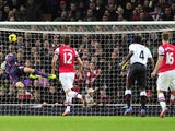 Arsenal's Welsh midfielder Aaron Ramsey scores his team's second goal during the English Premier League football match between Arsenal and Liverpool at the Emirates Stadium in north London, on November 2, 2013