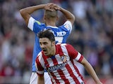 Atletico Madrid's forward David Villa celebrates after scoring during the Spanish league football match Club Atletico de Madrid vs Athletic Club Bilbao at the Vicente Calderon stadium in Madrid on November 3, 2013
