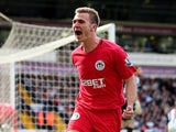 Callum McManaman of Wigan celebrates after scoring his team's third goal during the Barclays Premier League match against West Bromwich Albion on May 4, 2013