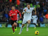 Swansea City player Michu outpaces Cardiff player Gary Medel during the Barclays Premier League match between Cardiff City and Swansea at Cardiff City Stadium on November 3, 2013