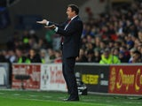 Cardiff manager Malky Mackay reacts during the Barclays Premier League match between Cardiff City and Swansea at Cardiff City Stadium on November 3, 2013