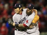 Koji Uehara #19 of the Boston Red Sox celebrates with teammate Mike Napoli #12 after throwing out Kolten Wong #16 of the St. Louis Cardinals to win Game Four of the 2013 World Series at Busch Stadium on October 27, 2013