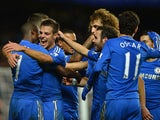 Ramires of Chelsea is congratulated by Cesar Azpilicueta and team mates after his goal during the Capital One Cup Fourth Round match between Chelsea and Manchester United at Stamford Bridge on October 31, 2012