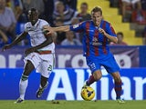 Christian Lell of Levante competes for the ball with Pereira of Granada during the La Liga match between Levante UD and Granada CF on November 3, 2013