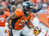 Denver Broncos' CJ Anderson runs with the ball during the game against Washington Redskins on October 27, 2013