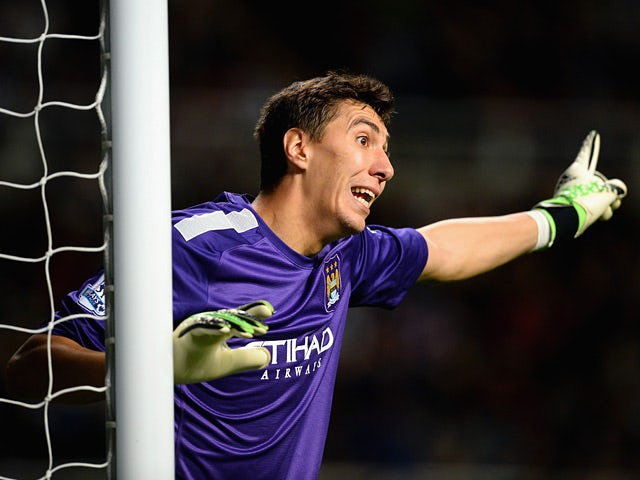 Man City goalkeeper Costel Pantilimon in action against Newcastle during their Capital One Cup Fourth Round match on October 30, 2013