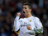 Real's Cristiano Ronaldo celebrates after scoring his team's third goal against Sevilla on October 30, 2013