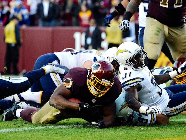 Darrel Young of the Washington Redskins scores the game-winning touchdown in overtime against the San Diego Chargers during an NFL game at FedExField on November 3, 2013