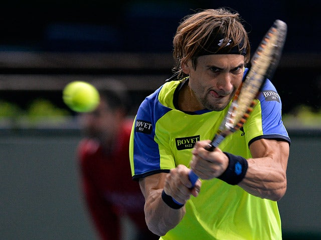 David Ferrer in action against Lukas Rosol during round two of the Paris Masters on October 30, 2013