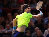 David Ferrer of Spain in action in his match against Rafael Nadal of Spain during day six of the BNP Paribas Masters at Palais Omnisports de Bercy on November 2, 2013