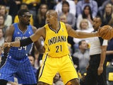 David West #21 of the Indiana Pacers handles the ball against Jason Maxiell #54 of the Orlando Magic during the game at Bankers Life Fieldhouse on October 29, 2013