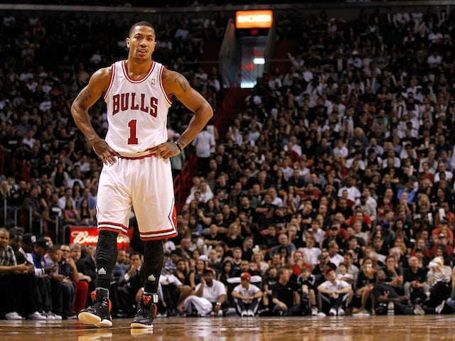 Derrick Rose of the Chicago Bulls looks on during a game against the Miami Heat at American Airlines Arena on January 29, 2012