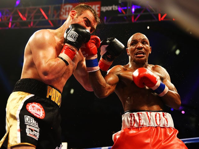 Devon Alexander punches Lee Purdy during their IBF Welterweight Title fight at Boardwalk Hall Arena on May 18, 2013