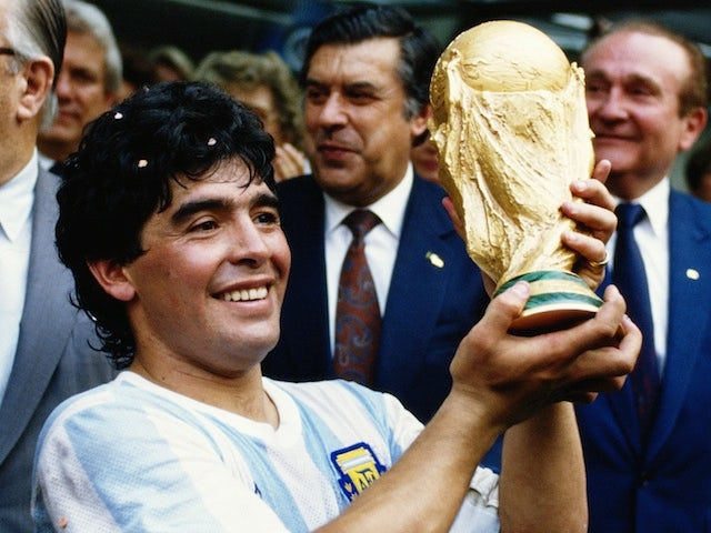 Diego Maradona of Argentina lifts the trophy and celebrates winning the FIFA World Cup final in Mexico City on June 29, 1986